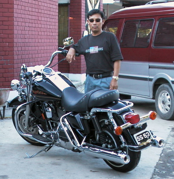 saludin and his bike; Actual size=130 pixels wide